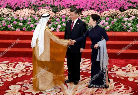 United Arab Emirates Vice President and Prime Minister Mohammed bin Rashid Al Maktoum (L) is welcomed by Chinese President Xi Jinping (C) and his wife Peng Liyuan for a welcoming banquet at the Belt and Road Forum at the Great Hall of the People in Beijing, China, 26 April 2019. Beijing hosts the Second Belt and Road Forum for International Cooperation