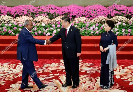 Djibouti President Ismail Omar Guelleh (L) is welcomed by Chinese President Xi Jinping (C) and his wife Peng Liyuan for a welcoming banquet at the Belt and Road Forum at the Great Hall of the People in Beijing, China, 26 April 2019. Beijing hosts the Second Belt and Road Forum for International Cooperation