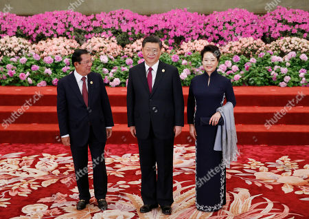 Cambodia's Prime Minister Hun Sen (L) is welcomed by Chinese President Xi Jinping (C) and his wife Peng Liyuan for a welcoming banquet at the Belt and Road Forum at the Great Hall of the People in Beijing, China, 26 April 2019. Beijing hosts the Second Belt and Road Forum for International Cooperation