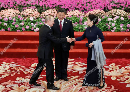 Chinese President Xi Jinping (C) with his wife Peng Liyuan (R) welcome Russian President Vladimir Putin (L) at a welcoming banquet for the Belt and Road Forum at the Great Hall of the People, in Beijing, China, 26 April 2019.