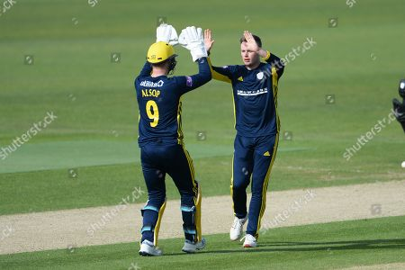 Tom Alsop and Mason Crane of Hampshire celebrates the wicket of Benny Howell during the Royal London 1 Day Cup match between Hampshire County Cricket Club and Gloucestershire County Cricket Club at the Ageas Bowl, Southampton
