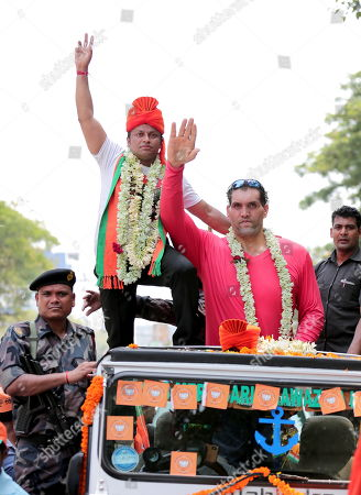 Stock Photo of Bharatiya Janata Party (BJP) candidate Anupam Hazra (L) with Indian professional wrestler and actor The Great Khali (R) participate in a rally of election nomination file for general election in Kolkata, Eastern India, 26 April 2019. India is going through general elections for 2019, which was started in seven rounds from 11 April, with the results to be announced on 23 May.