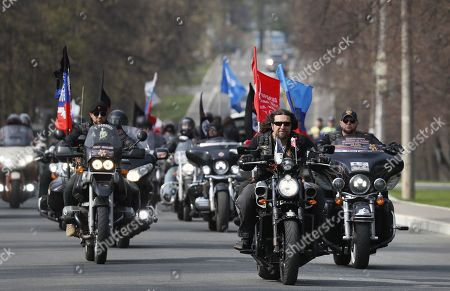 Alexander Zaldostanov (front), nicknamed 'Khirurg' (Surgeon), leader of the Russian motorcycle club the Night Wolves and his club-mates start their motorcycle race from Moscow to Berlin 'Victory Roads to Berlin 2019' in Moscow, Russia, 26 April 2019. Representatives from Russia, Germany, Poland, Slovakia, the Czech Republic and Italy take part in the race.