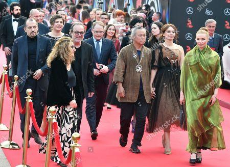 Stock Photo of Right to left: Finnish actress Maria Jarvenhelmi, actress Irina Bezrukova and chairman of the festival jury, South Korean director Kim Ki-Duk