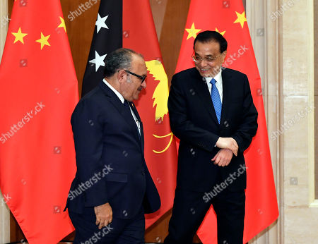 Stock Picture of Chinese Premier Li Keqiang (R) meets with Papua New Guinea Prime Minister Peter O'Neill (L) at the Diaoyutai State Guesthouse in Beijing, China, 26 April 2019.