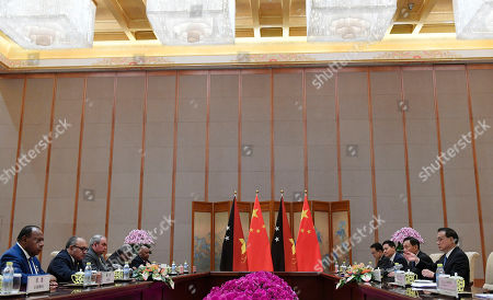 Chinese Premier Li Keqiang (R) with Papua New Guinea Prime Minister Peter O'Neill (2-L) attend their meeting at the Diaoyutai State Guesthouse in Beijing, China, 26 April 2019.