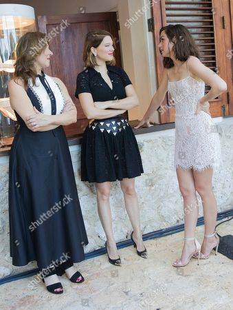Lea Seydoux, Ana de Armas, Barbara Broccoli. Barbara Broccoli, from left, Lea Seydoux and Ana de Armas pose for photographers during the photo call of the latest installment of the James Bond film franchise, currently known as 'Bond 25', in Oracabessa, Jamaica