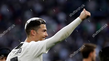 Juventus' Cristiano Ronaldo celebrates at the end of a Serie A soccer match between Juventus and AC Fiorentina, at the Allianz stadium in Turin, Italy, . Juventus clinched a record-extending eighth successive Serie A title, with five matches to spare, after it defeated Fiorentina 2-1