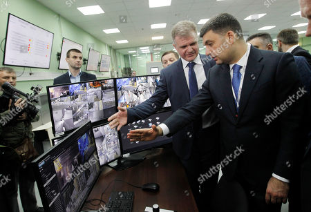 Ukrainian Prime Minister Volodymyr Groysman (R) looks on monitors as he visits a central control and management board of the protective shelter over the remains of the nuclear reactor Unit 4 at the Chernobyl nuclear power plant, in Chernobyl, Ukraine, 26 April 2019. Ukrainians mark the 33rd anniversary of Chernobyl tragedy.  In the early hours of 26 April 1986 the Unit 4 reactor at the Chernobyl power station blew apart. Facing nuclear disaster on unprecedented scale Soviet authorities tried to contain the situation by sending thousands of ill-equipped men into a radioactive maelstrom. The explosion of Unit 4 of the Chernobyl nuclear power plant is still regarded the biggest accident in the history of nuclear power generation.