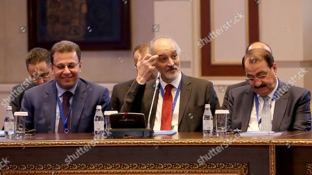 Stock Photo of Bashar Jaafari (C), Syria's permanent representative to the UN, attends the 12th round of talks on the Syrian conflict settlement in Nur-Sultan, Kazakhstan, 26 April 2019. The peace talks on Syria backed by Russia, Turkey, and Iran take place in the Kazakh capital on April 25-26, 2019.