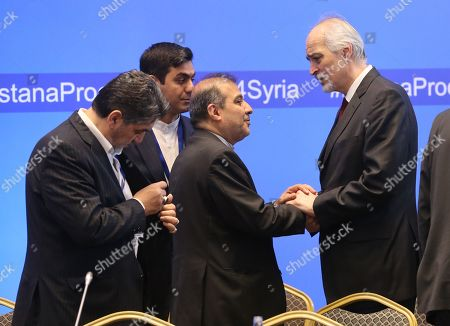 Stock Picture of Bashar Jaafari (R), Syria's permanent representative to the UN, attends the 12th round of talks on the Syrian conflict settlement in Nur-Sultan, Kazakhstan, 26 April 2019. The peace talks on Syria backed by Russia, Turkey, and Iran take place in the Kazakh capital on April 25-26, 2019.