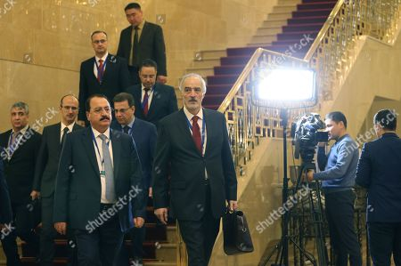 Syrian government delegation, headed by Bashar Jaafari (front R), Syria's permanent representative to the UN, arrive to attend the 12th round of talks on the Syrian conflict settlement in Nur-Sultan, Kazakhstan, 26 April 2019. The peace talks on Syria backed by Russia, Turkey, and Iran take place in the Kazakh capital on April 25-26, 2019.