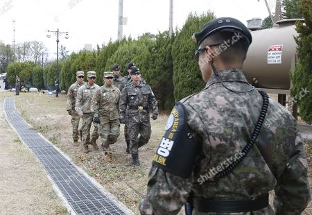 South Korean soldiers and US soldiers walk during a rehearsal for a Peace Performance to celebrate the First Anniversary of the Panmunjeom Declaration at the truce village of Panmunjom, Joint Security Area (JSA) of the Korean Demilitarized Zone (DMZ), 26 April 2019. The Panmunjom Declaration was adopted during the inter-Korean summit on 27 April 2018 aimed at cooperating on officially ending the Korean War and the Korean conflict, as well as includes the denuclearization of the Korean Peninsula.