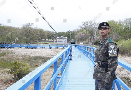 A South Korean soldier stands guard on the Blue bridge during a rehearsal for a Peace Performance to celebrate the First Anniversary of the Panmunjeom Declaration at the truce village of Panmunjom, Joint Security Area (JSA) of the Korean Demilitarized Zone (DMZ), 26 April 2019. The Panmunjom Declaration was adopted during the inter-Korean summit on 27 April 2018 aimed at cooperating on officially ending the Korean War and the Korean conflict, as well as includes the denuclearization of the Korean Peninsula.