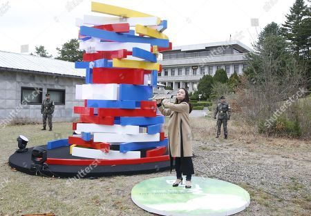 A woman plays the flute next to an unidentifed artwork during a rehearsal for a Peace Performance to celebrate the First Anniversary of the Panmunjeom Declaration at the truce village of Panmunjom, Joint Security Area (JSA) of the Korean Demilitarized Zone (DMZ), 26 April 2019. The Panmunjom Declaration was adopted during the inter-Korean summit on 27 April 2018 aimed at cooperating on officially ending the Korean War and the Korean conflict, as well as includes the denuclearization of the Korean Peninsula.