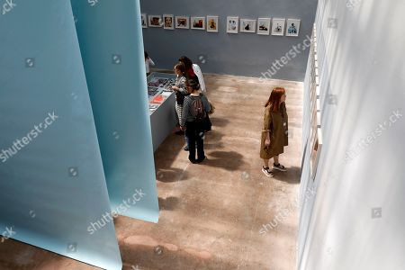 Visitors look at pictures on display in the exhibition 'One of One' by British photographer Craig McDean during the 34th International Festival of Fashion and Photography in Hyeres, southern France, 26 April 2019. The festival runs from 25 to 29 April.