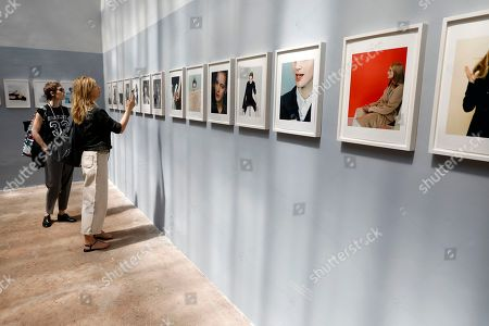 Stock Picture of Visitors look at pictures on display in the exhibition 'One of One' by British photographer Craig McDean during the 34th International Festival of Fashion and Photography in Hyeres, southern France, 26 April 2019. The festival runs from 25 to 29 April.