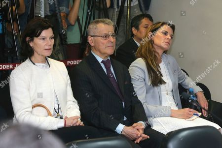 Stock Image of In this photo provided by Peru's Justice Palace press office, Miguel Kuczynski, brother of Peru's former President Pedro Pablo Kuczynski, center, sits next to the former president's daughters, Alex, right, and Carolina, left, as they attend the appeal of a three year pre-trial detention against Pedro Pablo Kuczynski, as prosecutors investigate links to Odebrecht, the Brazilian firm at the heart of Latin America's biggest graft scandal, in Lima, Peru