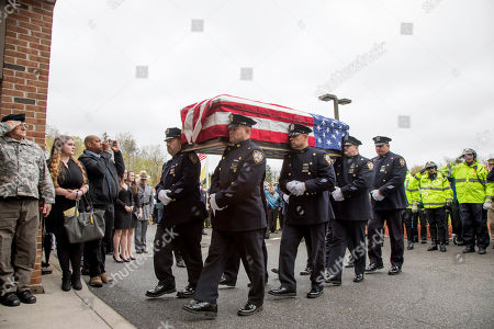 The casket of Marine Private First Class Robert Graham is carried into St.Elizabeth Ann Seton Church by members of the New York City Police Department on in Shrub Oak, NY. Graham, who died at 97, has no living family members but his friend Beth Regan arranged for hundreds to attend his funeral