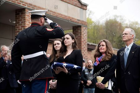 """Beth Regan is presented with the flag that draped the casket of her friend Marine Private First Class Robert Graham on in Shrub Oak, NY. Graham, who died at 97 has no living family members but Regan arranged for hundreds to attend his funeral. """"Receiving the flag was like receiving a part of him,"""" Regan said"""