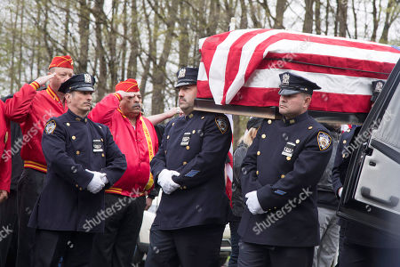The casket of Marine Private First Class Robert Graham is carried into St.Elizabeth Ann Seton Church by members of the New York City Police Department on in Shrub Oak, NY. Graham, who died at 97 has no living family members but his friend Beth Regan arranged for hundreds to attend his funeral