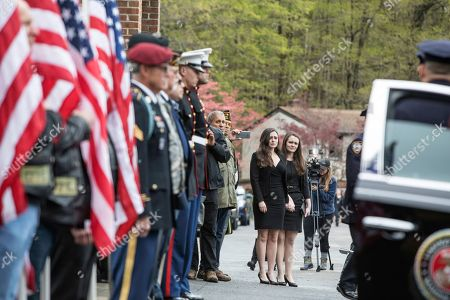Beth Regan, with her sister Sarah Regan by her side, cries as the casket of her friend, Marine Private First Class Robert Graham, is delivered to St. Elizabeth Ann Seton Church on in Shrub Oak, NY. Graham, who died at 97 has no living family members but Regan arranged for hundreds to attend his funeral
