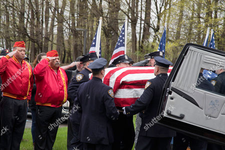 The casket of Marine Private First Class Robert Graham is carried into St. Elizabeth Ann Seton Church by members of the New York City Police Department on in Shrub Oak, NY. Graham, who died at 97 has no living family members but his friend Beth Regan arranged for hundreds to attend his funeral
