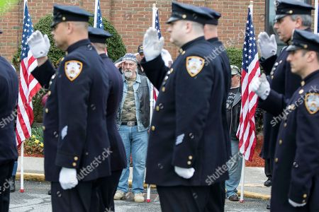 Stock Picture of Members of the New York Police Department as well as Charlie Kalpaxis of the NY Riders salute the casket of Marine Private First Class Robert Graham on in Shrub Oak, NY. Graham has no living family members but his friend Beth Regan arranged for hundreds to attend his funeral