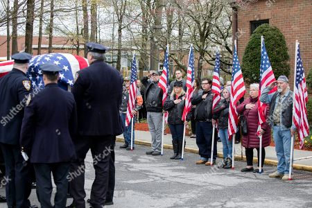 The casket of Marine Private First Class Robert Graham is carried out of St.Elizabeth Ann Seton Church by members of the New York City Police Department on in Shrub Oak, NY. Graham, who died at 97 has no living family members but his friend Beth Regan arranged for hundreds to attend his funeral