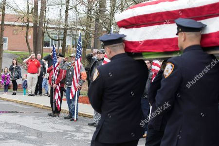 Stock Image of The casket of Marine Private First Class Robert Graham is carried out of St.Elizabeth Ann Seton Church by members of the New York City Police Department on in Shrub Oak, NY. Graham, who died at 97 has no living family members but his friend Beth Regan arranged for hundreds to attend his funeral