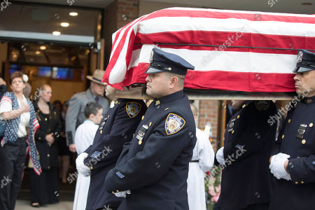Stock Photo of The casket of Marine Private First Class Robert Graham is carried out of St.Elizabeth Ann Seton Church by members of the New York City Police Department on in Shrub Oak, NY. Graham, who died at 97 has no living family members but his friend Beth Regan arranged for hundreds to attend his funeral