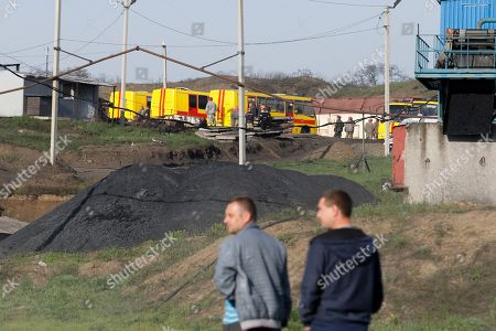 Stock Image of Locals look on the rescuers work on the 'Shidcarbon' coal mine close to the pro-Russian militants controlled Yuryevka village of Luhansk area, Ukraine, 26 April 2019. By this moment dead bodies of 5 miners killed in the explosion had been found, and the destiny of twelve more remains unknown. The gas explosion on the 'Shidcarbon' coal mine took place on 25 April 2019.