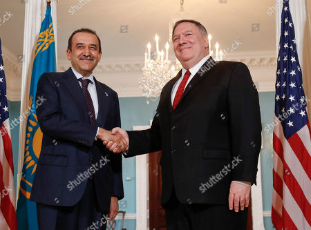 Stock Image of Mike Pompeo, Karim Masimov. Secretary of State Mike Pompeo, right, meets with Kazakhstani National Security Committee Chairman Karim Masimov, left, at the State Department in Washington