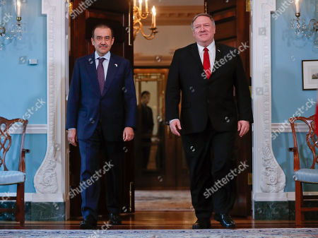 Mike Pompeo, Karim Masimov. Secretary of State Mike Pompeo, right, walks out with Kazakhstani National Security Committee Chairman Karim Masimov, left, at the State Department in Washington