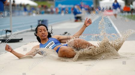 Kendell Williams lands in the pit during the women's special long jump at the Drake Relays athletics meet, in Des Moines, Iowa