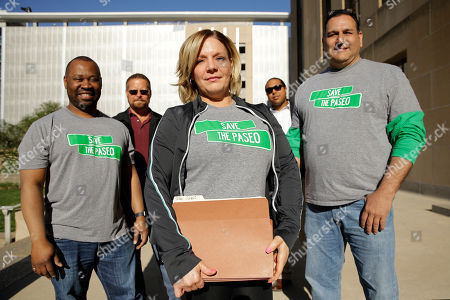 Tara Green, center, holds a petition with 2,857 signatures as she stands with other citizens opposed to changing the name of the Paseo Boulevard to Rev. Martin Luther King Jr. Boulevard before presenting it to the city clerk, in Kansas City, Mo. More than 50 years after the King was assassinated, the question of how to honor him divides Kansas City residents
