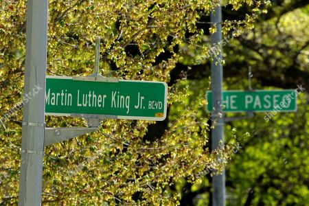 April, 20, 2019, a newly changed sign for Dr. Martin Luther King, Jr. Boulevard stands in contrast to a yet-to-be changed sign for The Paseo in Kansas City, Mo. More than 50 years after King was assassinated, the city's efforts to honor the civil rights leader has met opposition from citizens opposed to the renaming of The Paseo, one of the city's iconic boulevards