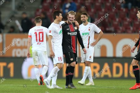 l-r: Ja-Cheol Koo #19 (FC Augsburg) and Julian Brandt #10 (Bayer 04 Leverkusen)    , FC Augsburg vs. Bayer 04 Leverkusen, Football, 1.Bundesliga, 26.04.2019, DFL REGULATIONS PROHIBIT ANY USE OF PHOTOGRAPHS AS IMAGE SEQUENCES AND/OR QUASI-VIDEO