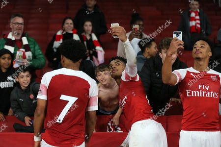 Tyreece John-Jules (centre) and Cohen Bramall of Arsenal enjoy a selfie with their fans at the final whistle during Arsenal Under-23 vs Leicester City Under-23, Premier League 2 Football at the Emirates Stadium on 26th April 2019