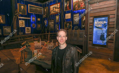 """Hamilton exhibition creative director and designer David Korins, poses for a portrait at the exhibit in Chicago, . Korins is standing in one of 19 rooms that make up a 360-degree immersive experience to accompany """"Hamilton"""" the musical. Visitors can follow Alexander Hamilton's life as a trader in St. Croix to his death in a duel with Aaron Burr in 1804"""