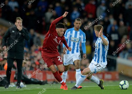 Liverpool's Alex Oxlade Chamberlain (L) vies for the ball against Huddersfield  Erik Durm (R) during the English Premier League match between Liverpool FC and Huddersfield  at Anfield, Liverpool, Britain, 26 April 2019.