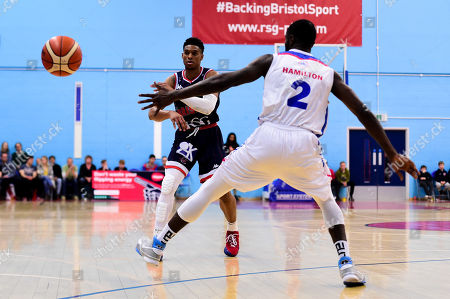 Justin Gray of Bristol Flyers is marked by Ashley Hamilton of London City Royals
