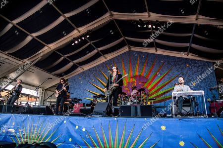 Zack Feinberg, David Shaw, Ed Williams. Zack Feinberg, from left, David Shaw, and Ed Williams of The Revivalists performs at the New Orleans Jazz and Heritage Festival, in New Orleans