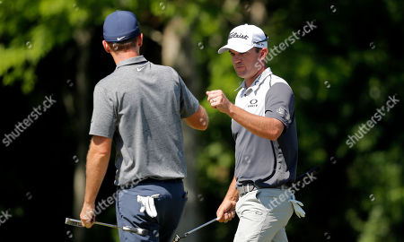 Ryan Blaum, right, greets teammate Russell Henley after finishing the 10th hole during the second round of the PGA Zurich Classic golf tournament at TPC Louisiana in Avondale, La