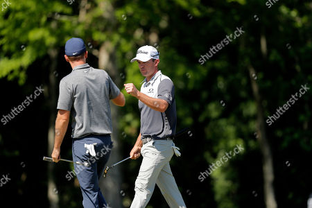 Stock Photo of Ryan Blaum, right, greets teammate Russell Henley after finishing the 10th hole during the second round of the PGA Zurich Classic golf tournament at TPC Louisiana in Avondale, La