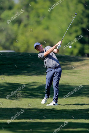 Russell Henley hits off the 11th fairway during the second round of the PGA Zurich Classic golf tournament at TPC Louisiana in Avondale, La