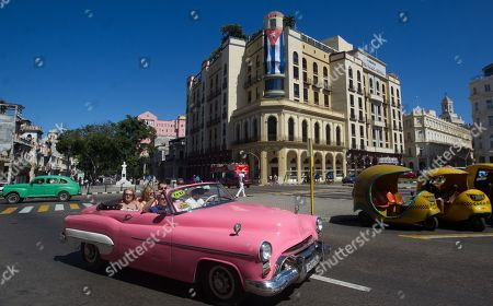 A classic American car travels with tourists through the streets of Havana, Cuba, 26 April 2019.