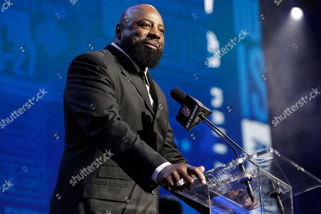 Former Dallas Cowboys player Ed Jones announces the Cowboys pick as Central Florida defensive tackle Trysten Hill during the second round of the NFL football draft, in Nashville, Tenn
