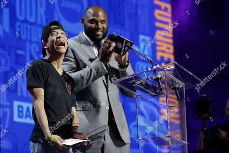 Baltimore Ravens fan Miles Davis, left, announces the Ravens selection of Louisiana Tech's Jaylon Ferguson during the third round of the NFL football draft, in Nashville, Tenn