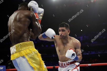 England's Amir Khan, right, during the second round of a WBO world welterweight championship boxing match against Terence Crawford, in New York. Crawford won the fight